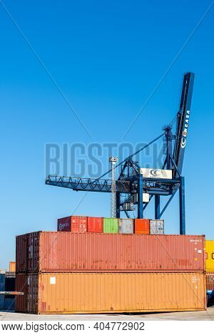 Harbor Crane And Freight Containers In The Industrial Port In Cadiz