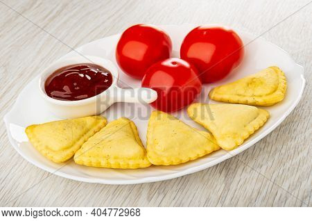 Sauce Boat With Ketchup, Red Tomatoes, Small Savory Pies In Glass White Dish On Wooden Table