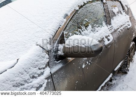 Car Under The Snow In Winter Time