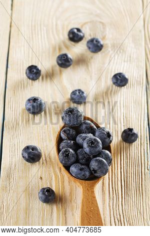 Blueberries. Freshly Picked Blueberries Over Wooden Table. Juicy And Fresh Blueberries.