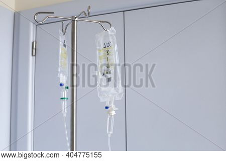 Benidorm, Spain - January 04, 2021: Iv Bag Hanging On A Metal Pole In The Room.
