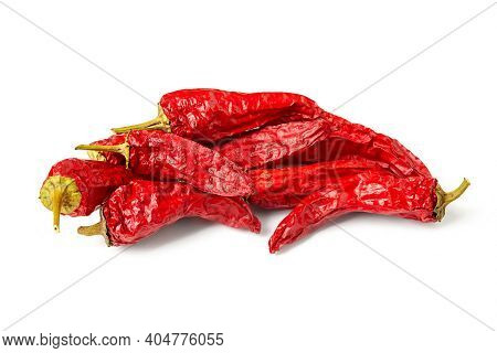 Red Pepper. Heap Of Dry Peppers On A White Background. Hot Chili Peppers. Spices For Cooking.