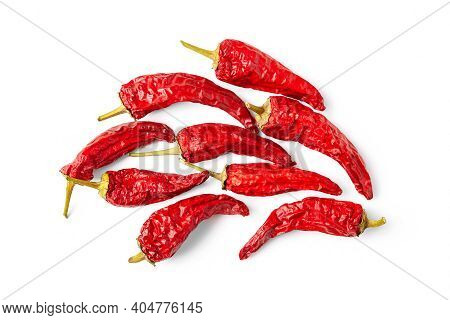 Red Pepper. Top View Of A Pile Of Dry Pepper On A White Background. Hot Chili Peppers. Spices For Co
