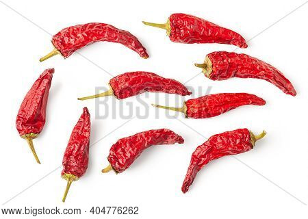 Red Pepper. Top View Of A Lot Of Dry Peppers On A White Background. Hot Chili Peppers. Spices For Co