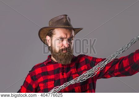 Metal Chain. Serious Bearded Man. Man With Metal Chain. Dependence. Freedom. Bearded Man With Chain.