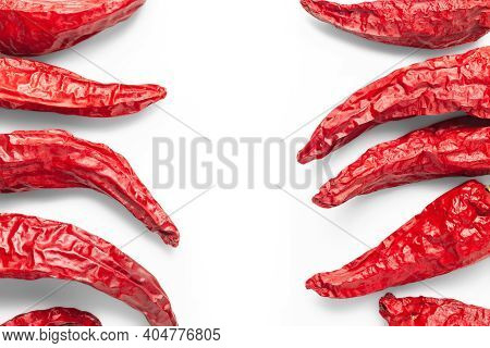 Top View Of Red Peppers. Dry Peppers Laid Out On A White Background. Hot Chili Peppers. Spices For C