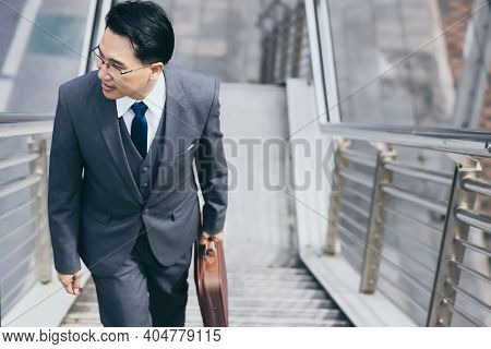 Happy Businessman Going To His Office For Work In Morning By Walking On Steps Of Overpass With Happy