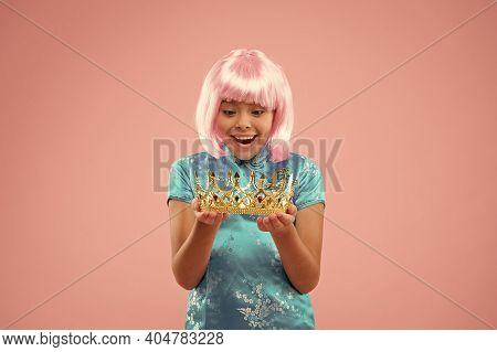 Winning Pageant Crown. Happy Girl Hold Crown Pink Background. Little Miss Got Reward. Beauty Queen C