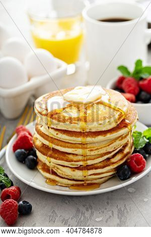 Fluffy Buttermilk Pancakes With Butter And Maple Syrup