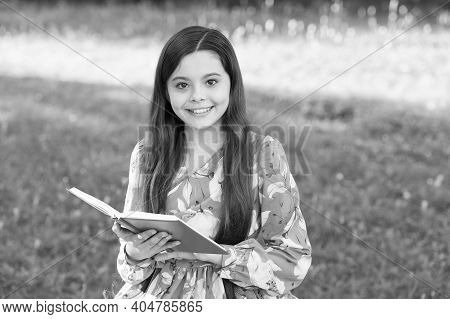 Make Friends With Book. Happy Child Hold Book In Summer Park. Childrens Literature. Literature And P