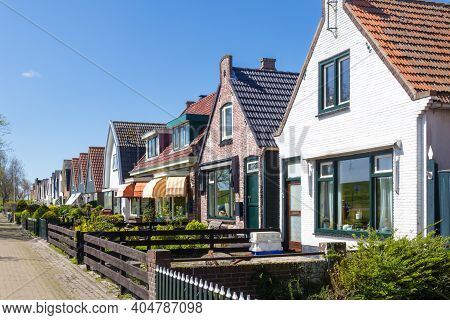 Texel, Netherlands, May, 2018: Village Oudeschild With A Row Of Trraditional Fisherman Houses On Tex