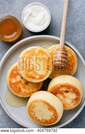 Cottage Cheese Fritters Syrniki With Honey. Top View. Ricotta Fritters Or Pancakes