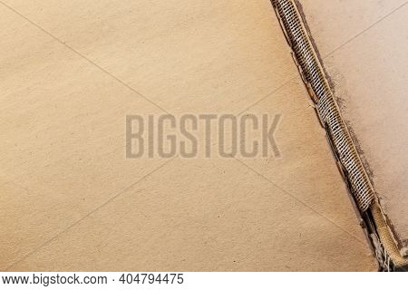 Vintage Abstract Background Texture Of Shabby Yellowed Brown Cardboard Paper With Damaged Binding Of