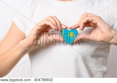 Love Kazakhstan. The Girl Holds A Heart In The Form Of The Flag Of Kazakhstan On Her Chest. Kazakh P
