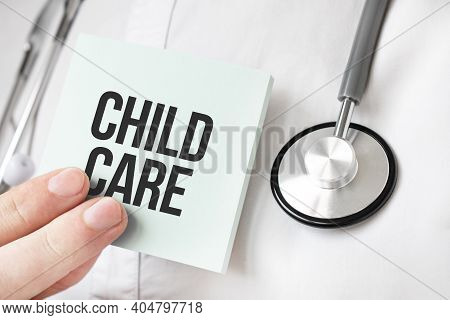 Doctor Holding Card In Hands And Pointing The Word Child Care