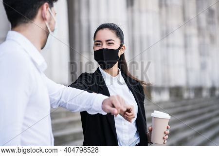 Portrait Of Two Business People Bumping Elbows