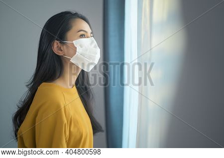 Young Beautiful Woman Wearing A Protective Facial Mask Getting Ready To Go Outside, Healthcare And C