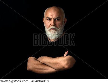 Serious Senior Man. Close Up Portrait Of An Elegant Senior Man With Grey Hair Isolated On Black Back