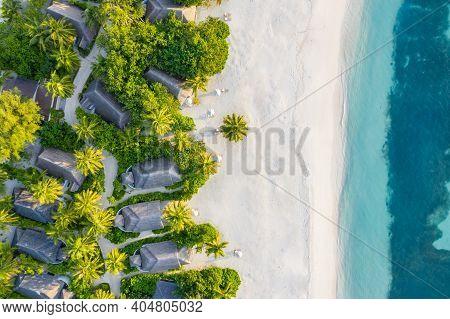 Aerial Top View Tropical Island White Sand Beach With Blue Lagoon Sea Sky In Maldives Island, Beauti