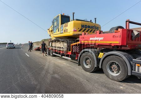 Russia, Krasnodar, European Route E-97: September 17, 2020-workers Load A Komatsu Limited Crawler Ex