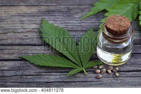 Cannabis Essential Oil In A Glass Jar On Wooden Background.cbd Cosmetics,marijuana,hemp Extract, Her
