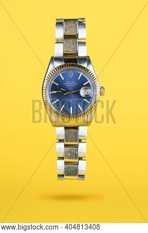 Cremona, Italy - January, 2021: Rolex Oyster Blue Watch On Yellow Background. Rolex Sa Is An Importa