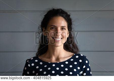 Headshot Portrait Of Smiling Caucasian Female Renter Posing