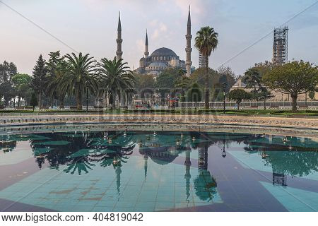 Beautiful View On Blue Mosque Or Sultanahmet Camii In Istanbul, Turkey With Reflection In Fountain O