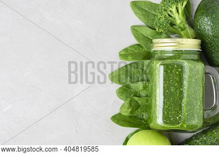 Healthy Green Smoothie In A Jar With Made Of Spinach, Broccoli, Avocado, Apple And Cucumber. Top Vie