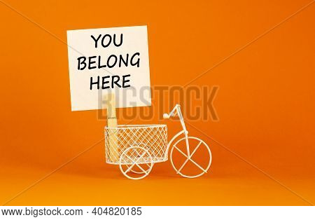 You Belong Here Symbol. Wooden Clothespin With White Paper. Words You Belong Here. Miniature White B