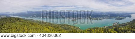 Aerial View Of The Alpine Lake Worthersee, Famous Tourist Attraction For Many Water Activity In Klag