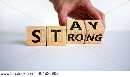 Stay Strong Symbol. Businessman Turns Cubes With Words 'stay Strong'. Beautiful White Background. Mo