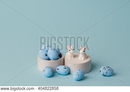 Quail Blue Easter Eggs On Blue Background. Minimal Comcept With Copy Space. Spring Holidays Decor. T
