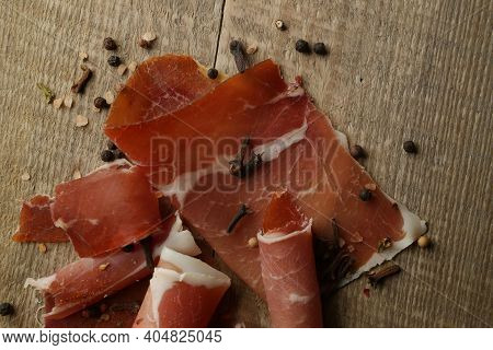 Sliced Jamon On A Wood Background. Parma Ham, Jamon On Wooden Background With Space For Text Top Vie