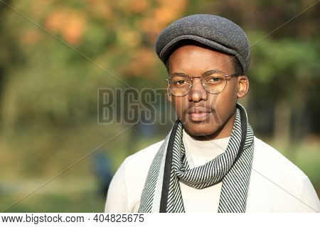 Portrait Of Serious Pensive Handsome Black African Afro American Young Man In Stylish Fashionable Ha