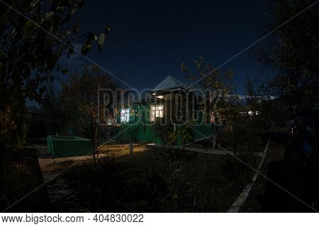 Mountain Night Landscape Of Building At Forest At Night With Moon Or Vintage Country House At Night