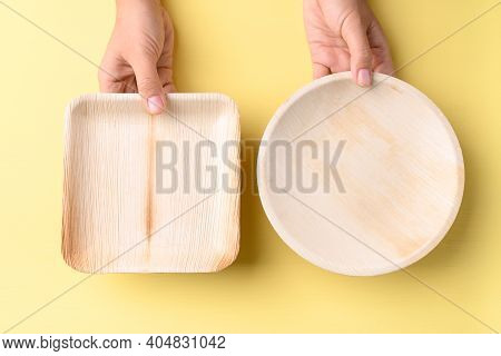 Hand Holding Betal Palm Leaf Plate (biodegradable, Compostable, Disposable Or Eco Friendly Plate) On