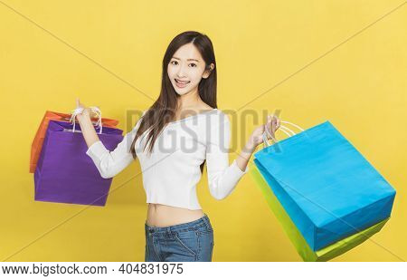 Beautiful Young Woman With Shopping Bags Background