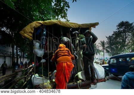 Kolkata, West Bengal, India - 12th January 2020 : Hindu Devotees Getting Up To A Truck To Reach Gang