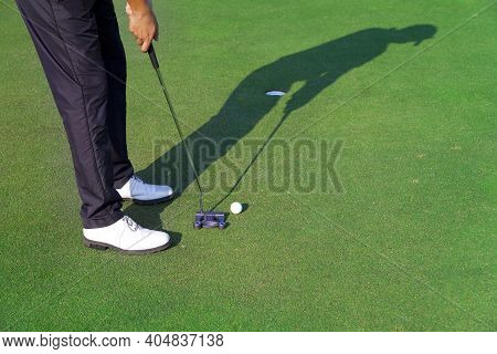 Golf Player Is Putting On The Green