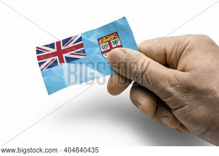 Hand Holding A Card With A National Flag The Fiji