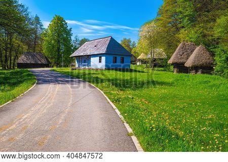 Walkway And Cute Old Peasant Houses In The Astra Museum, Sibiu, Tansylvania, Romania, Europe