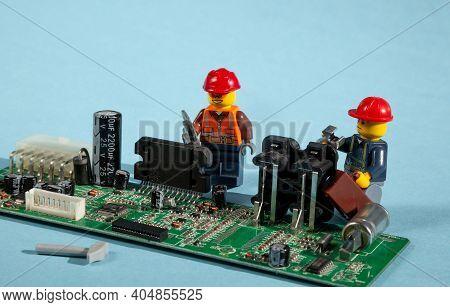 Ukraine, Kyiv - April 6, 2020: Computer Repair Lego Men. Workers And Engineers. Repairmen And Crafts