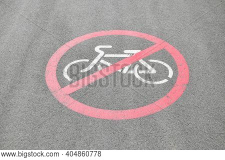 Bicycle Riding Prohibited Symbol On Tarred Road. Cycling Forbidden Sign Printed On The Ground On Asp