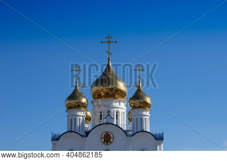 Golden Domes Of The Church Of St. Nicholas Against The Blue Sky. Petropavlovsk-kamchatsky, Russia.