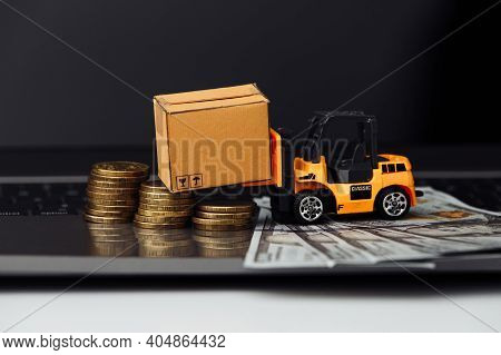 Mini Model Of Forklift With Boxes On Laptop Close-up. Logistics And Wholesale Concept