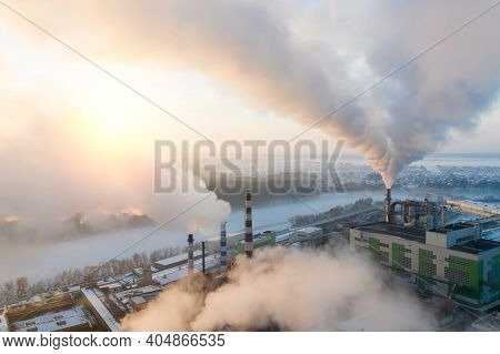 Smoke From Factory Chimneys On The Background Of Sunrise.