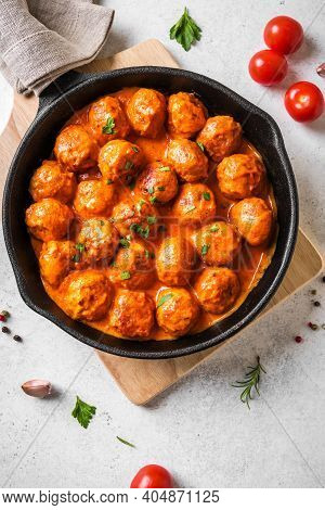 Homemade Meatballs In Tomato Sauce Close Up. Beef Meatballs In Cast Iron Pan On White Background.