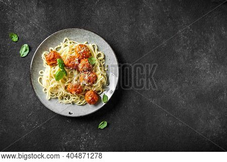 Spaghetti Pasta With Meatballs, Tomato Sauce, Grated Cheese And Fresh Basil - Healthy Homemade Itali