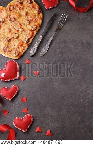 Romantic Dinner, Pizza Heart, Bright Red Hearts And Cutlery. Vertical Image. Top View